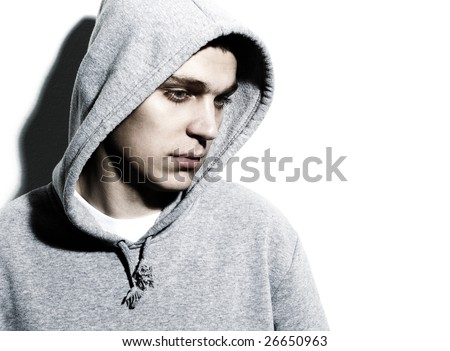 young man wearing hooded sweatshirt - stock photo