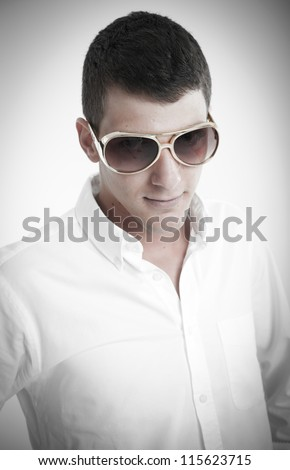Young man wearing kitsch golden glasses