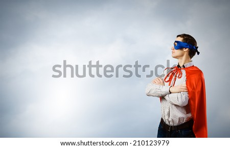 Young man wearing man mask and cape - stock photo