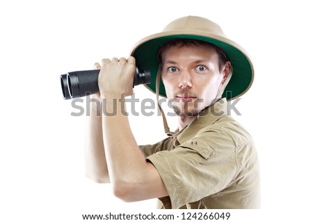 Young man wearing safari shirt and pith helmet holding binoculars, isolated on white background, side view - stock photo