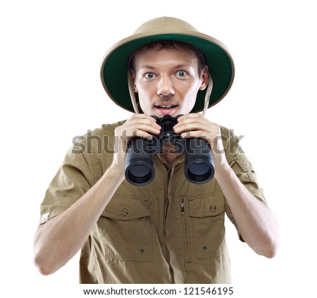 Young man wearing safari shirt and pith helmet lowering binoculars, isolated on white background - stock photo