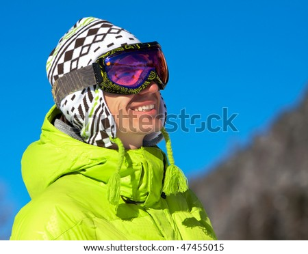 Young man wearing ski mask and sport jacket. Winter vacation in Alps - stock photo