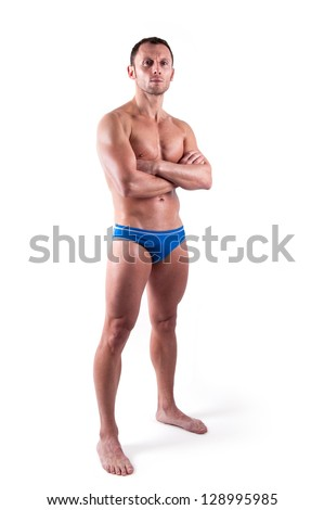 Young man wearing swimsuit isolated over white background. Full body.