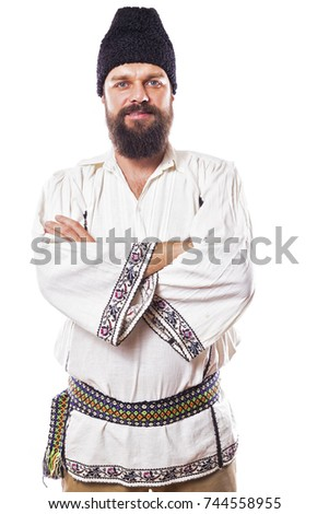 young man wearing traditional romanian costume on white background