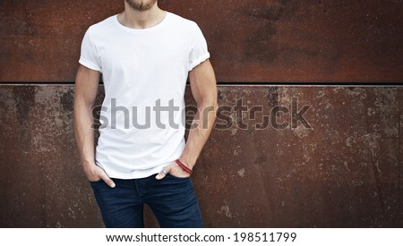 Young man wearing white t-shirt - stock photo
