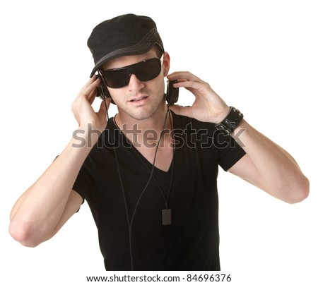 Young man wears pair of headphones over white background - stock photo