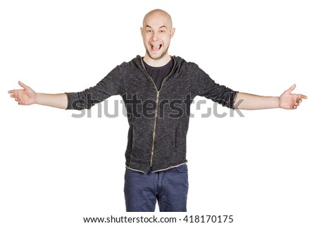 young man welcoming everyone with his arms wide open and a big smile. emotions, facial expressions, feelings, body language, signs. image on a black studio background. - stock photo