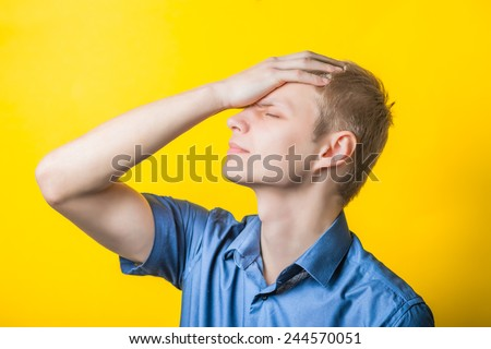 Young man, what do I do? Angry young man makes a gesture of frustration. Photo . - stock photo
