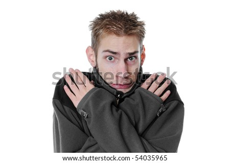 Young man white adult male crosses his arms and shivers with his turtleneck sweater isolated on white background. - stock photo