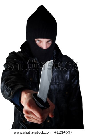 Young man wielding a large-bladed knife