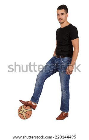 young man with a ball on a white background - stock photo