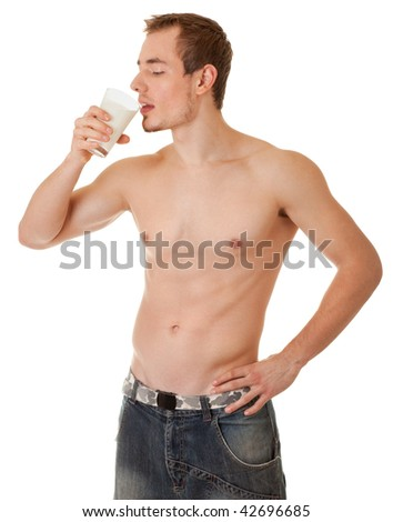 young man with a bare torso holding a glass of white liquid