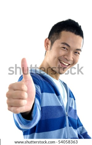 young man with a big smile and thumbs up sign