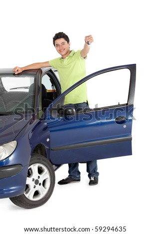 Young man with a car holding the keys - isolated over a white background - stock photo