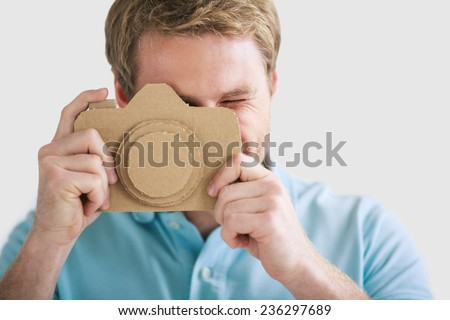 Young man with a cardboard camera - stock photo