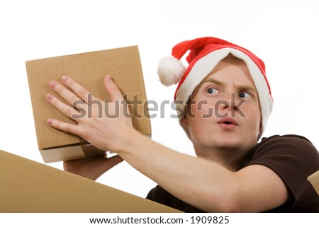 young man with a christmas cap and a blank package