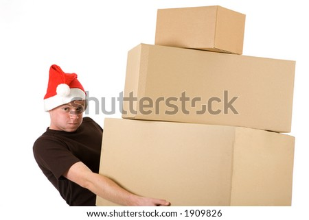 young man with a christmas cap who lifts up a pyramid of blank packages
