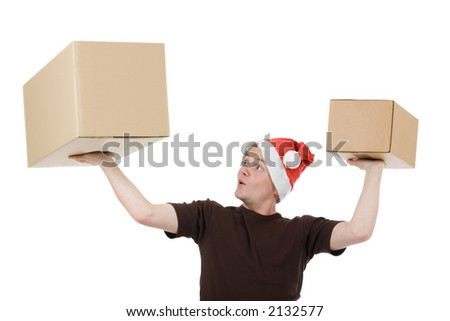 young man with a christmas cap who lifts up two blank packages