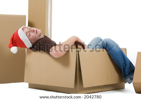 young man with a christmas hat sleeps in a package