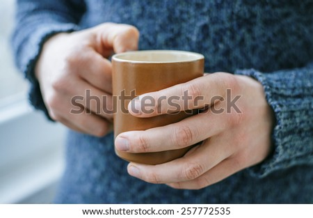 young man with a cup - stock photo