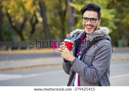 Young man with a cup of coffee in New York city. - stock photo
