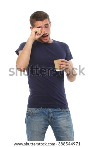 young man with a cup of coffee yawning. isolate on white background - stock photo