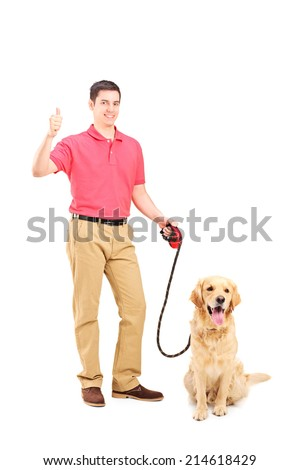 Young man with a dog giving thumb up isolated on white background