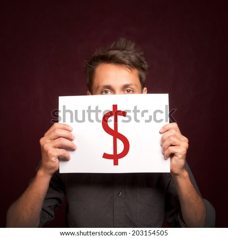 Young man with a dollar sign on a card half covering face
