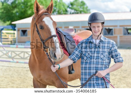young man with a horse - stock photo