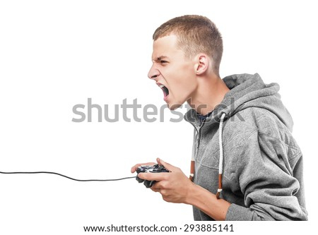 Young man with a joystick for game console side view. Isolated on white. - stock photo