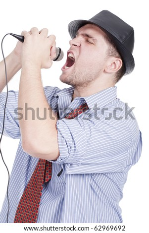 Young man with a microphone and singing - stock photo