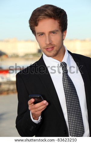 Young man with a mobile phone - stock photo