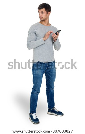 Young man with a modern smartphone in your hands, isolated on white.