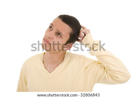Young man with a pensive expression looking up - stock photo