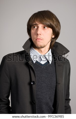Young man with a serious eye looking to the side. - stock photo