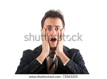 Young man with a shocked facial expression - stock photo