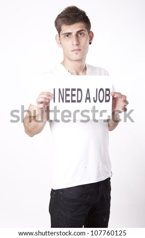 Young man with a sign I need a job - stock photo