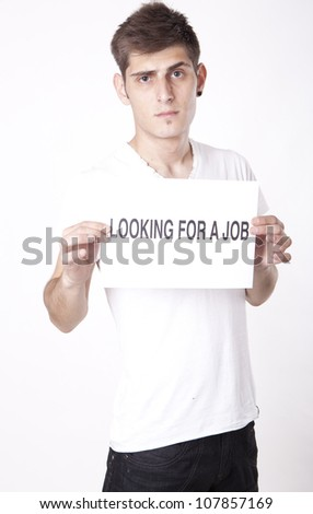 Young man with a sign looking for a job - stock photo