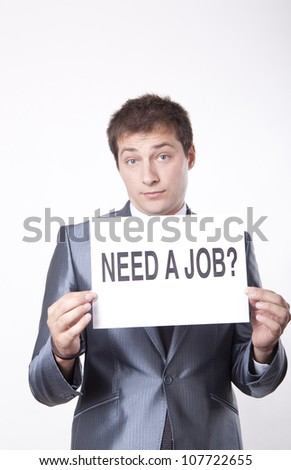Young man with a sign need a job?. - stock photo