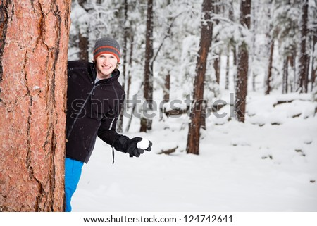 Young Man with a Snowball (Ready for Snowball Fight) - stock photo