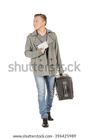 young man with a suitcase and a map on a white background