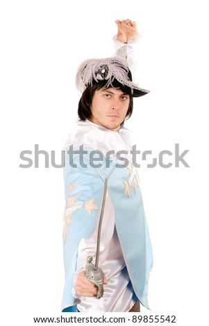 Young man with a sword dressed as musketeer