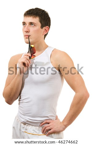 young man with a thoughtful expression on his face - stock photo