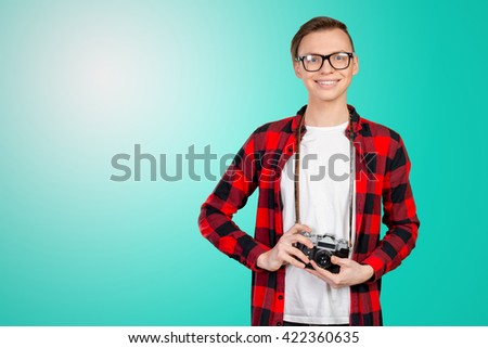 Young man with a vintage camera