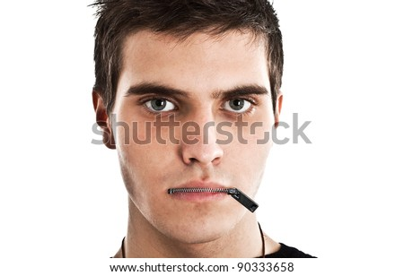 Young man with a zip on his mouth, representing censorship - stock photo