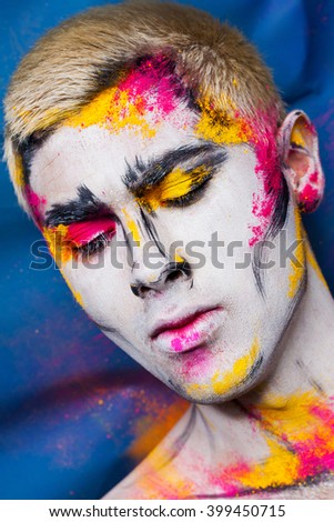 young man with abstract faceart - stock photo