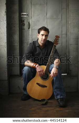 Young man with an acoustic guitar.
