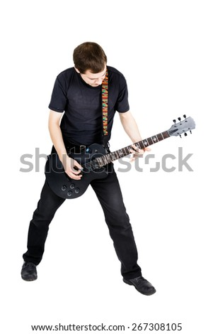young man with an electric guitar. Isolated on white background - stock photo