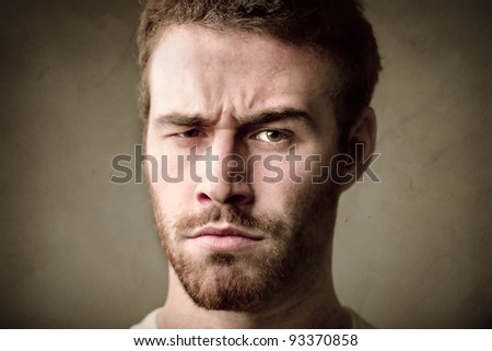 Young man with angry expression