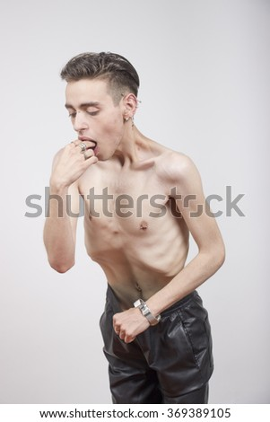 Young man with anorexia nervosa and Bulimia nervosa problem. White background. - stock photo